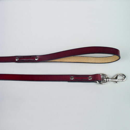 Genuine leather dog leash with chrome plated solid brass leash clip.
