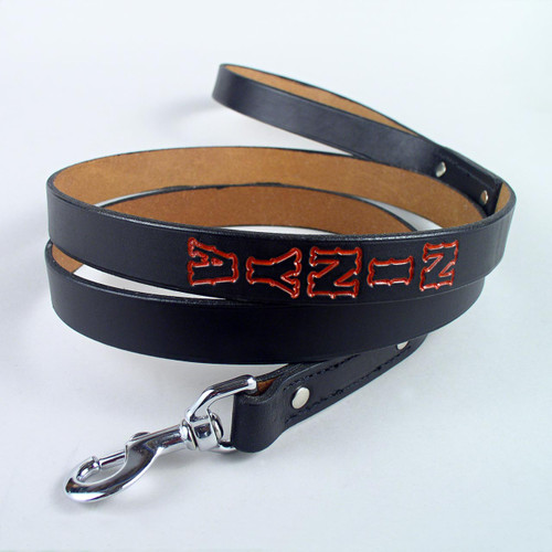 Black personalized leather dog leash six feet long with red hand painted imprint letters.