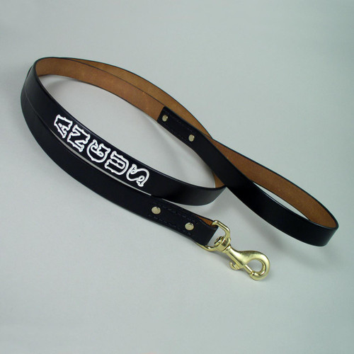 Deep imprinted white hand painted lettering on solid leather leash.
