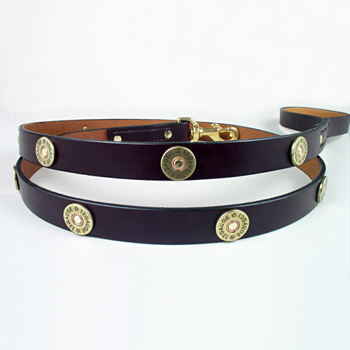 Three foot solid leather shot gun shell dog leash with sturdy rivets and stitching.