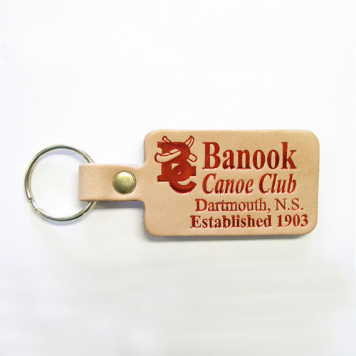 Red imprinted key tag on natural leather.