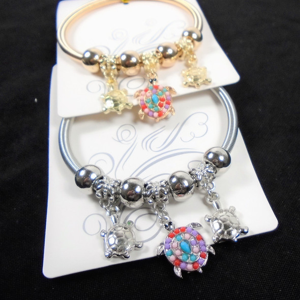 Gold & Silver Spring Style Bracelet w/ Turtle  Charms   .60  ea