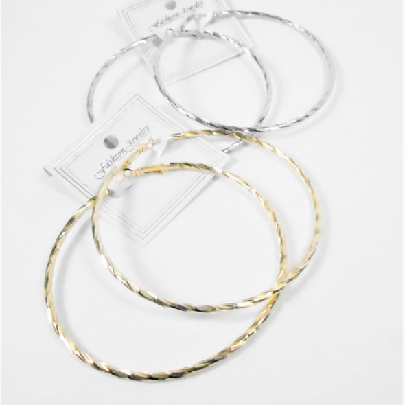 """3"""" Swirl Pattern Fashion Gold & Silver Hoop Earrings .54 per pair"""