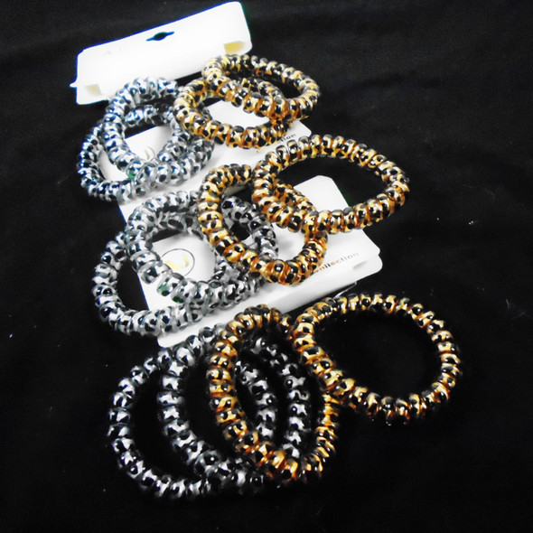 4 Pack Phone Coil Ponytailers/Bracelets Gold/Sil Animal Print   .56 per set