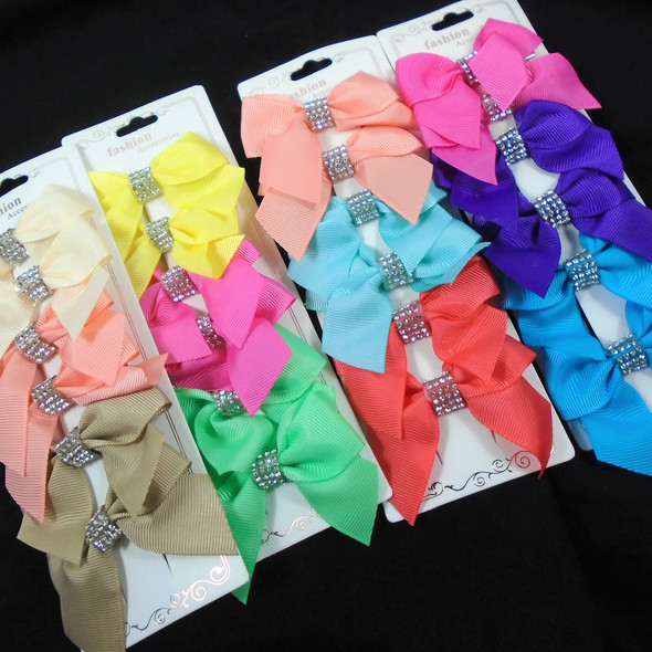 """6 Pack 2.5"""" Gator Clip Bows w/ Cry. Stone Center  .54 per set"""
