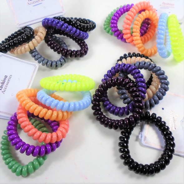 6 Pack Phone Coil Style Ponytailers/Bracelets  .58 per set