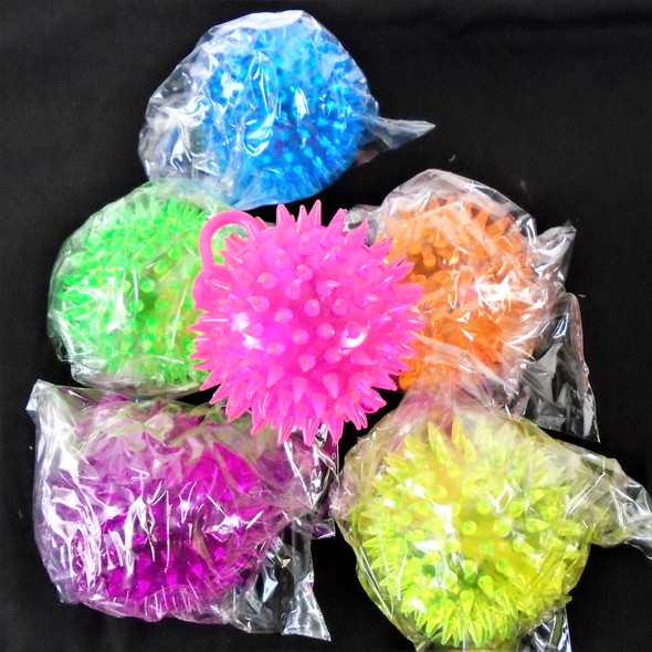 "2.5"" Spikey & Squeakie Flashing Balls w/ YoYo   12 per pk Asst Colors .60 each"
