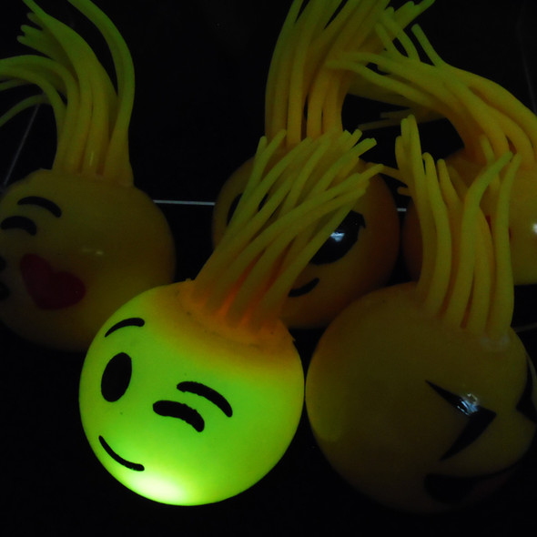 """2"""" X 4"""" Spaghetti Hair Flashing Emoji Rubber Balls 12 per display bx .62 ea"""