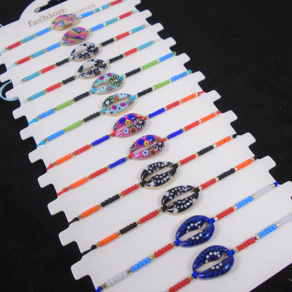 Mini Beaded Cord Bracelet w/ Colored Metal Cowrie Shell  Charm 12 per card  .56 ea