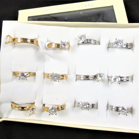 Gold / Silver Stainless Steel Rings w/ Cry. Stone on Sides   .60 each