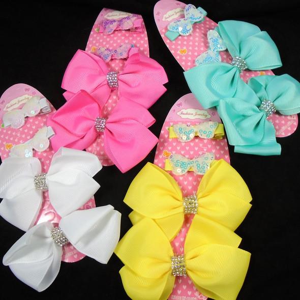 "4 Pack  Clip Bow Set Mixed Light Colors 2-4"" Bows & 2 Clips  .56 per set"
