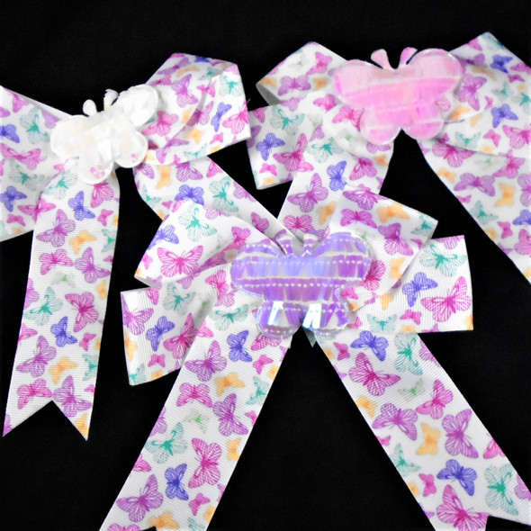 """6"""" Butterfly Print Tail Style Gator Clip Bows w/ Sequin Butterfly Center 12 per pk  .58 each"""