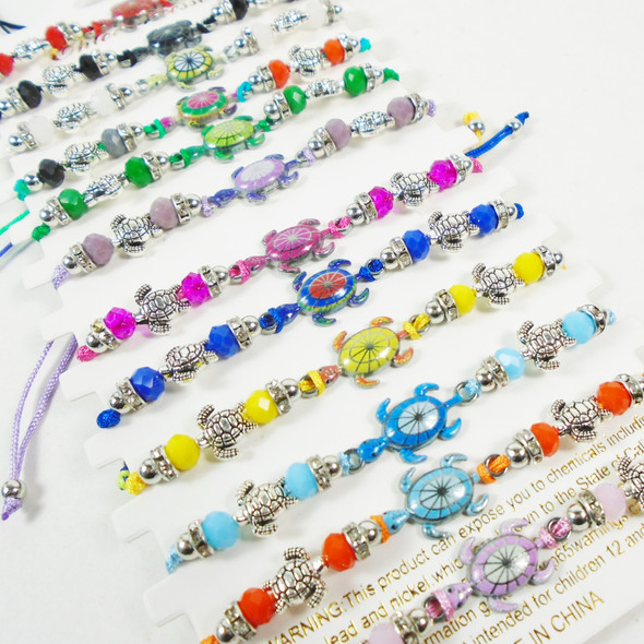Colorful Beaded Cord Bracelet w/ Silver & Colored Turtle Charm   12 - per cd  .56 each
