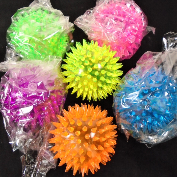 "3"" Spikey & Squeakie Flashing Balls  w/ YoYo12 per pk Asst Colors .65 each"