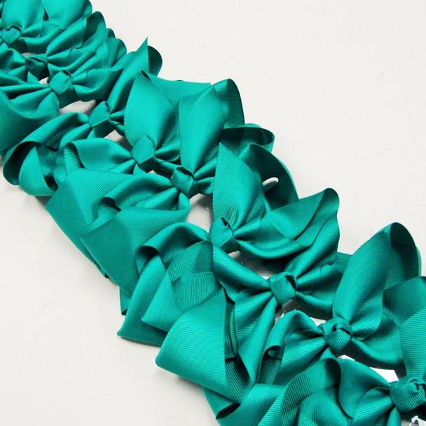 """6"""" Emerald Green Color  Gator Clip  Bows as shown .45 ea"""
