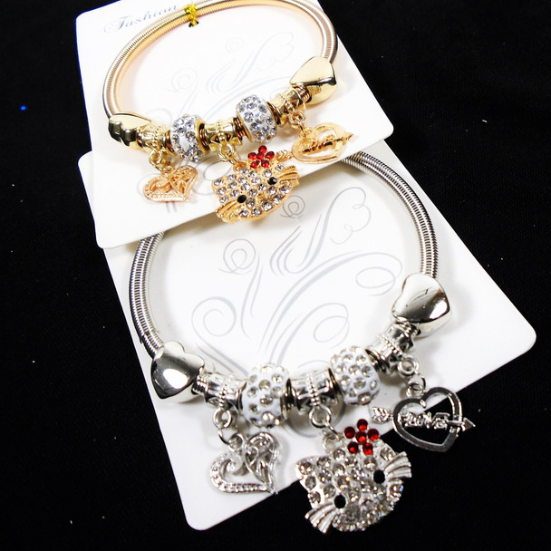 Gold & Silver Spring Style  Bracelet w/ Heart/Cat Charms  .60  each