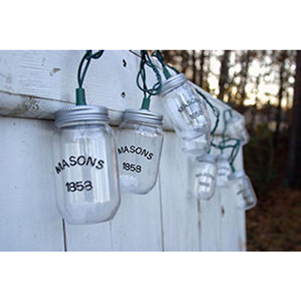 Mason Jar String Lights on fence