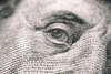 close-up of a 20-dollar bill and Benjamin Franklin's face