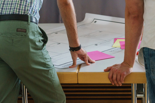 people at a desk brainstorming