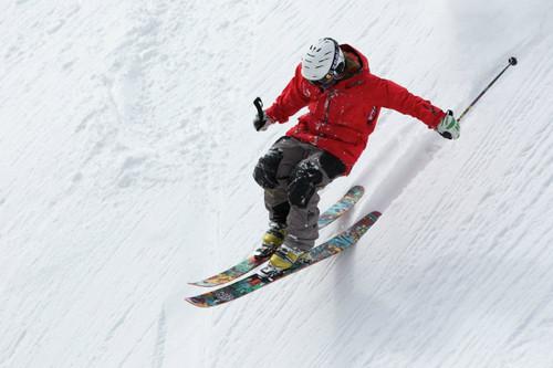 man skiing downhill