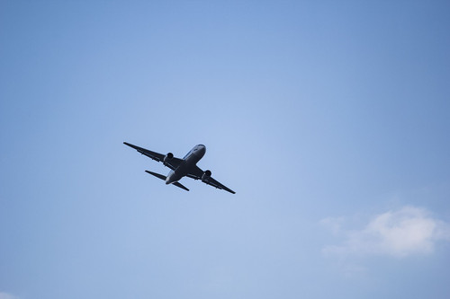 airplane crosses a clear blue sky