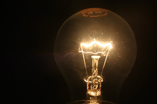 lit vintage light bulb