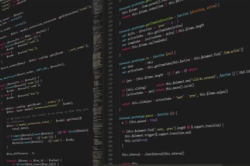 multi-panel code on black backlit computer screen