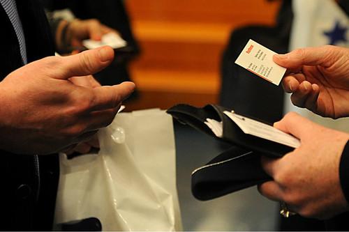 businessmen exchange business cards