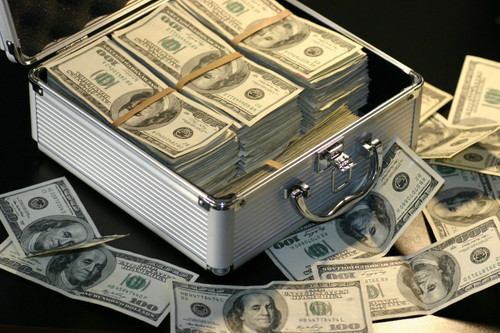 briefcase full of stacks of $100 bills