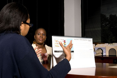 two businesswomen mid conversation