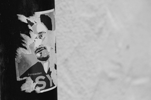 poster of Snowden partially removed on telephone post