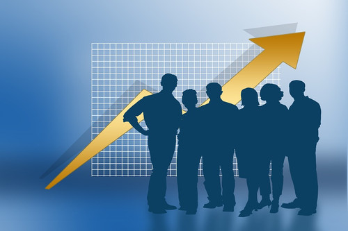 graphic of business people standing in front of graph