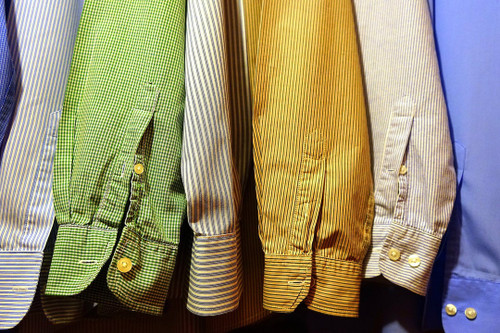 a close of the sleeves of colorful button-down shirts