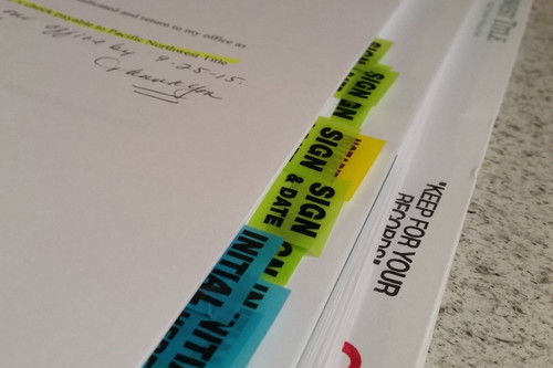 close-up of the tabs on mortgage contracts