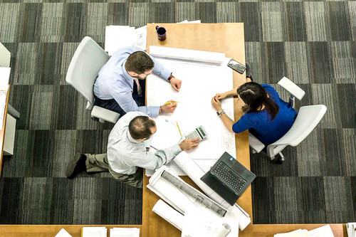 bird's eye view of business people working on project