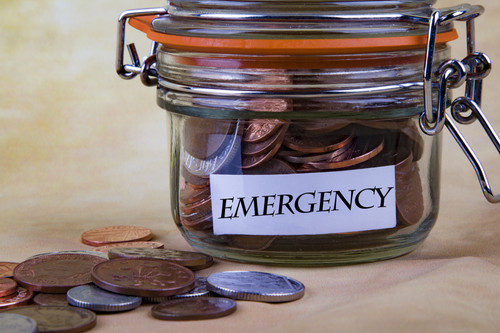 "jar with coins labeled ""emergency"""