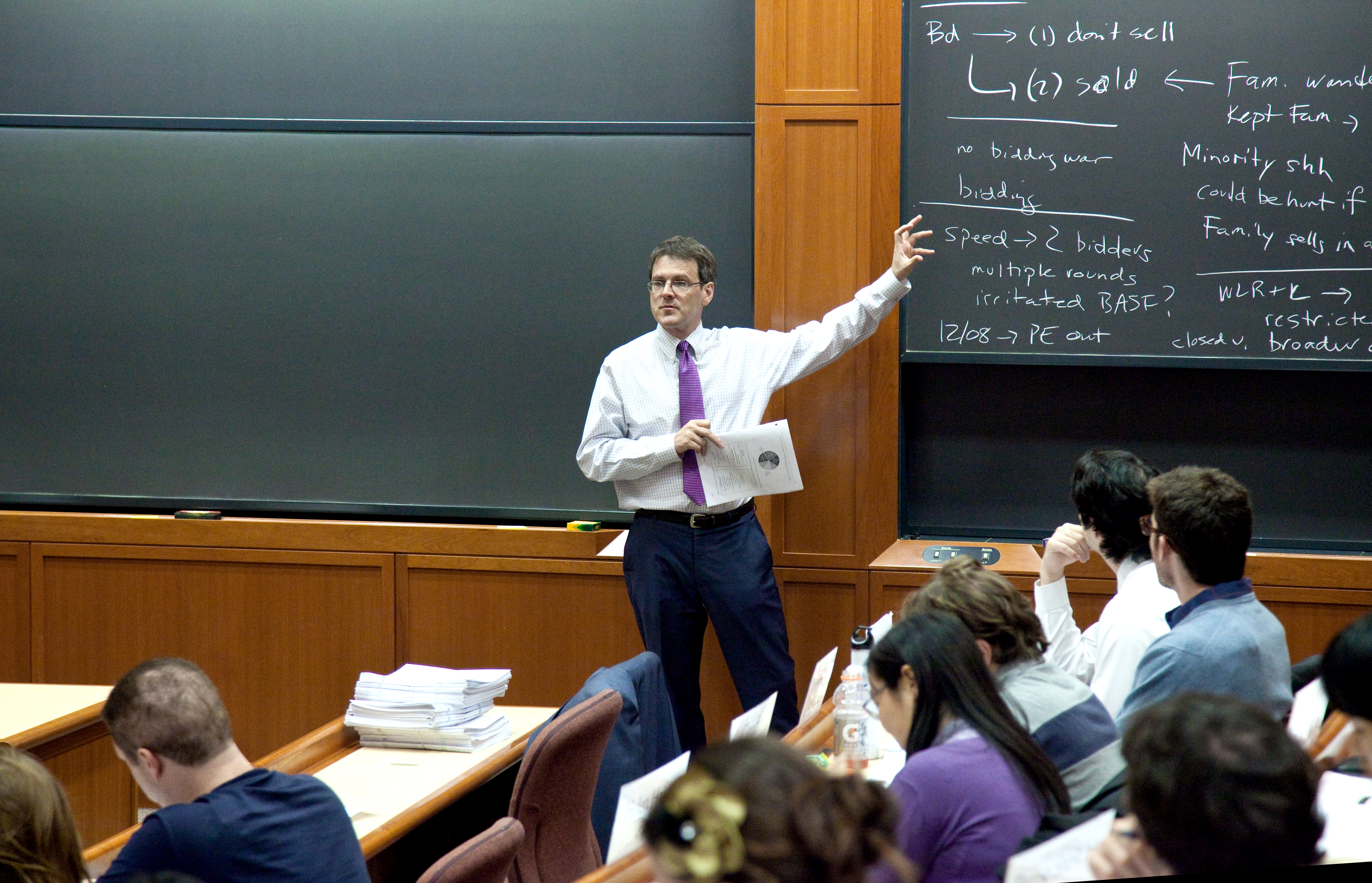 Professor John Coates lecturing to his class at the blackboard