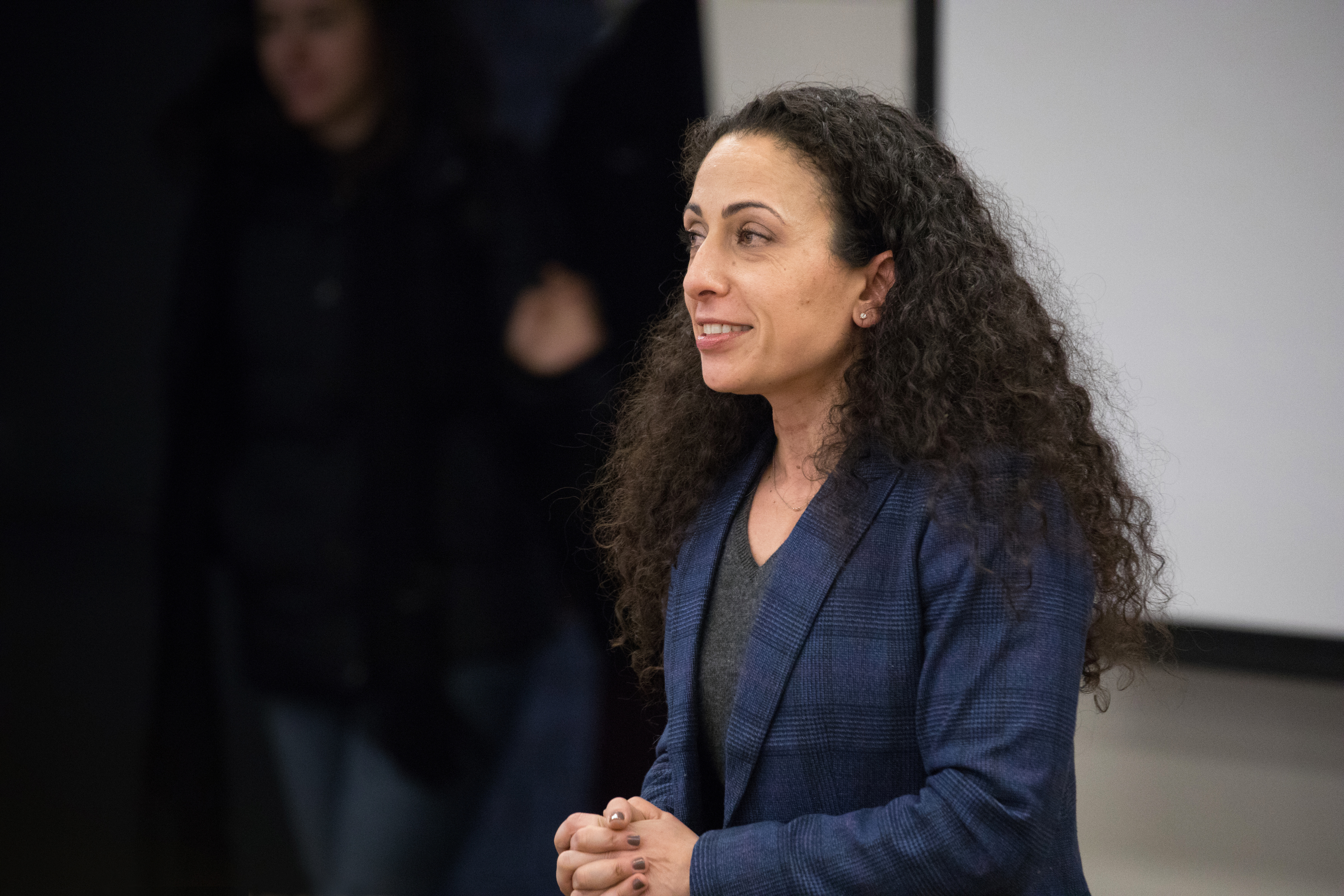 Professor Naz Modirzadeh lecturing her class