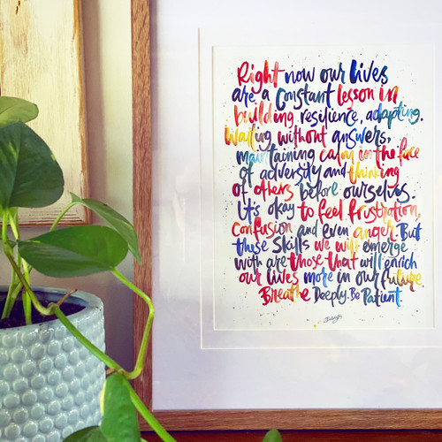 Rainbow brush calligraphy print in frame.
