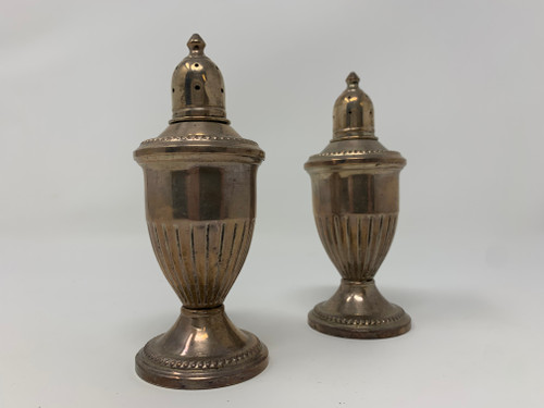 A Pair of Salt And Pepper Shakers 1920
