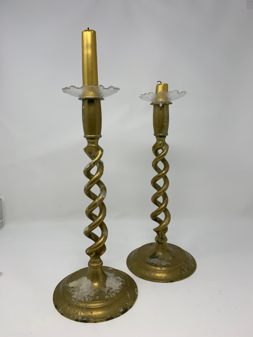 An Antique Pair of Twisted Brass Candlesticks