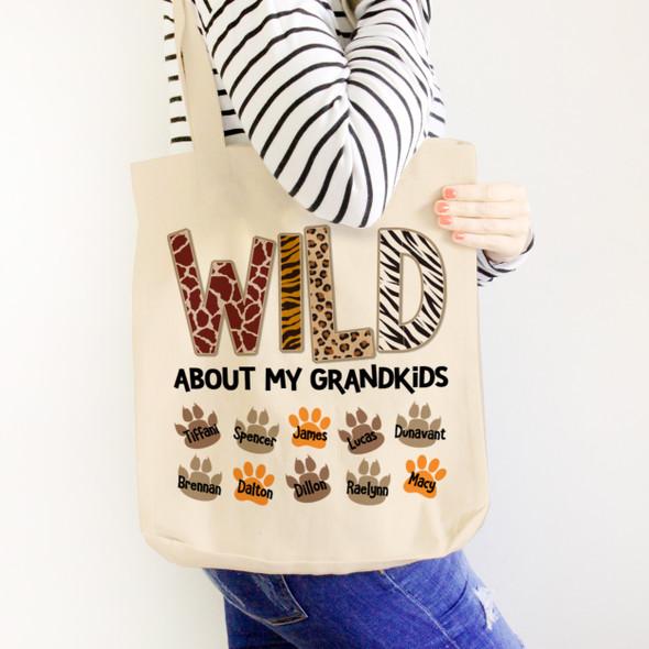 Wild about my grandkids paw print tote bag