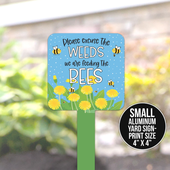 Excuse the weeds feeding the bees yard sign
