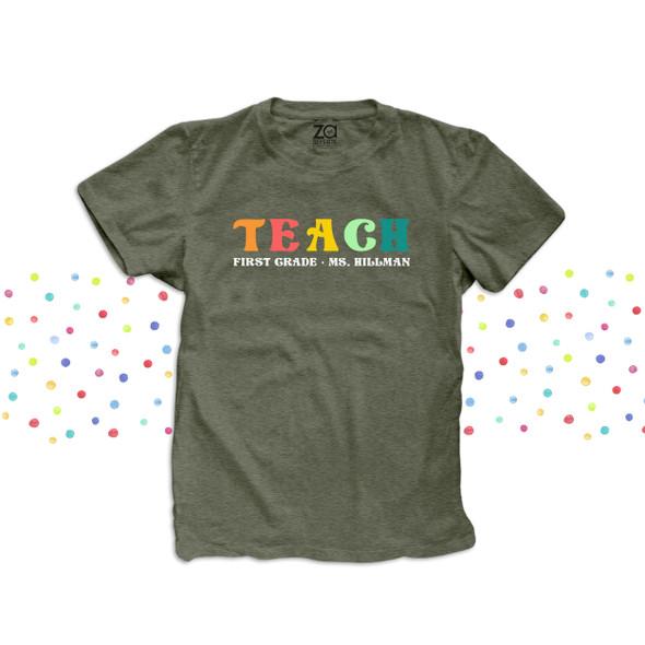 First grade teach rainbow color text any grade personalized team teacher DARK shirt