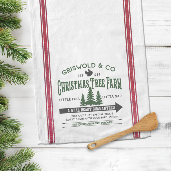 Griswold & Co christmas tree farm a real beaut funny holiday tea towel