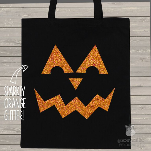 Halloween sparkly pumpkin face trick or treat bag