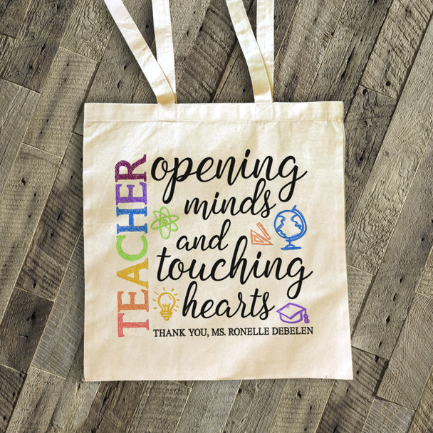 Teacher opening minds tote bag