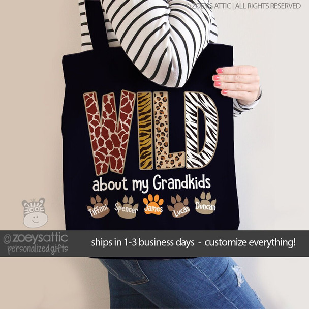 Wild about my grandkids paw print DARK tote bag