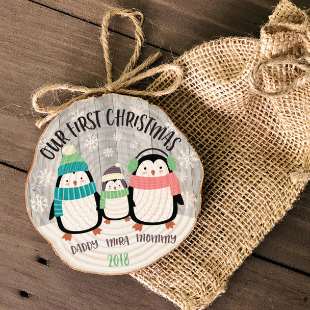 Our First Christmas penguin family wood slice ornament