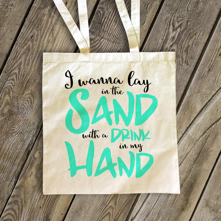 Lay in the sand with a drink in my hand tote bag